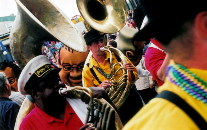 A Mardi Gras band takes the streets during the Montreal Jazz Festival